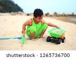 cute little boy play on beach | Shutterstock . vector #1265736700