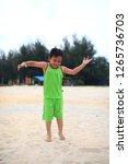 cute little boy play on beach | Shutterstock . vector #1265736703