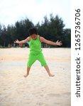 cute little boy play on beach | Shutterstock . vector #1265736706