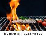 selective focus grilling steaks ... | Shutterstock . vector #1265745583