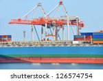 container stack and ship under... | Shutterstock . vector #126574754