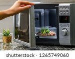 using the microwave oven to... | Shutterstock . vector #1265749060
