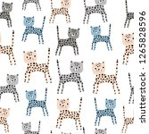 Stock vector seamless pattern with cute hand drawn leopards creative childish texture great for fabric 1265828596