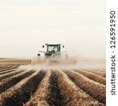 A Tractor Planting A Potato...