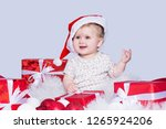 cute smiling baby girl  in a... | Shutterstock . vector #1265924206