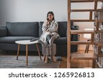 beautiful young female at home... | Shutterstock . vector #1265926813