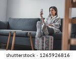 beautiful young female at home... | Shutterstock . vector #1265926816