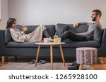 beautiful young couple in love... | Shutterstock . vector #1265928100