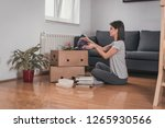 moving into new apartment .... | Shutterstock . vector #1265930566