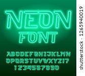 green neon tube alphabet font.... | Shutterstock .eps vector #1265940019