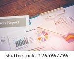 business report chart preparing ... | Shutterstock . vector #1265967796