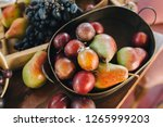 wedding rings are in the plate... | Shutterstock . vector #1265999203