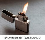 Silver Metal Lighter On Black...