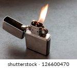 silver metal lighter on black... | Shutterstock . vector #126600470