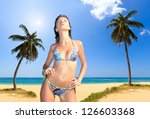 beautiful woman on a tropical ... | Shutterstock . vector #126603368