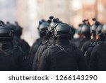 Small photo of anti terrorism squad with military equipment with special tactical force counter terrorism assault technology