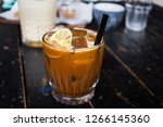 a cold coffee beverage with a... | Shutterstock . vector #1266145360