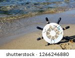 captain's wheel on the seashore | Shutterstock . vector #1266246880