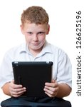 boy holding a tablet computer | Shutterstock . vector #126625196
