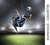 football player in blue shirt... | Shutterstock . vector #126628748