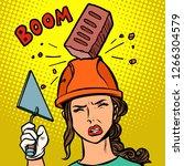 female builder brick falls on... | Shutterstock .eps vector #1266304579