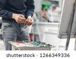 close up of an artist's hand... | Shutterstock . vector #1266349336