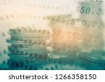 double exposure of coins and... | Shutterstock . vector #1266358150