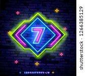 number seven symbol neon sign... | Shutterstock .eps vector #1266385129