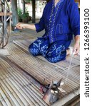 Small photo of Cotton spinning process female blue cloth hand and finger Bamboozle bed rotation