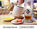 english tea in a cafe   cup and ... | Shutterstock . vector #1266423283