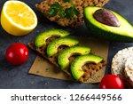 risp sandwich with avocado.... | Shutterstock . vector #1266449566