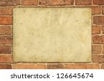 old paper on old red brick wall