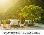 Tourism vacation and travel. Caravan trailer on sunny beach in Greece - stock photo