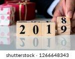 hand holding wooden cubes... | Shutterstock . vector #1266648343