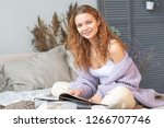 beautiful young girl is sitting ...   Shutterstock . vector #1266707746