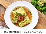 swabian dumplings in broth ...   Shutterstock . vector #1266717490
