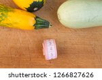 zucchini on a wooden table.... | Shutterstock . vector #1266827626