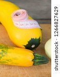zucchini on a wooden table.... | Shutterstock . vector #1266827629
