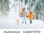 father and son dressed in warm... | Shutterstock . vector #1266872953