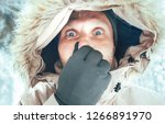 funny man dressed in warm... | Shutterstock . vector #1266891970