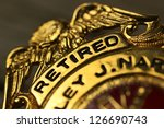 Small photo of Closeup of a badge awarded to a civil servant