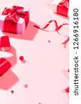 gift red satin ribbon and beads ... | Shutterstock . vector #1266916180