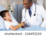 Doctor Visiting Child Patient...