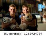 dogs bring them joy. muscular... | Shutterstock . vector #1266924799