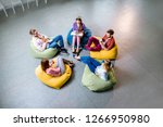 group of a young coworkers... | Shutterstock . vector #1266950980
