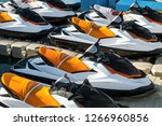 Colored Jet Skis Parked On...