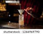 bartender pouring a lemonade... | Shutterstock . vector #1266969790