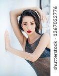portrait of beautiful brunette...   Shutterstock . vector #1267022776