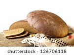 Bread rye  on an old background - stock photo