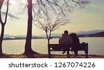 lake sunshine and couple | Shutterstock . vector #1267074226